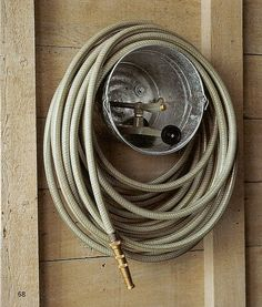 Summer Homekeeping Tips Bucket Hose Storage A galvanized paint bucket makes a practical and inexpensive caddy for a garden hose and sprinkler. How to Make the Bucket Hose Storage Next: Foldaway Trellis