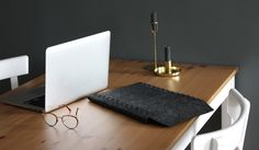 These laptop sleeves are self-assembled by threading arrow-shaped tabs on the side of the material into laser-cut slots.