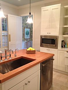 Go for the Big Sink! White cabinets are hot! A natural wood top can be a beautiful functional accent.  This Palm Beach kitchen features Shaker style cabinets. For more info email me at artfulkitchensbyglo@gmail.com