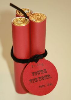 "The dynamite was made from Rollo's candy rolled with red paper.  The wick is a bit of black licorice and the bundle is tied with some black pipe cleaner. This Valentine could read, ""You're Dynamite!"" or ""You're a Blast"" or ""You're the Bomb."""