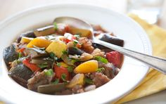 Ratatouille, a traditional French vegetable dish of eggplant, bell peppers, onions, summer squash and tomatoes, is an ideal side dish to serve with grilled or roasted fish or chicken.
