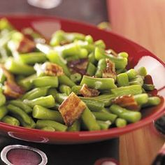 Green Beans in Beer Sauce: 1/3 pound bacon strips (diced), 1 package (16 oz) frozen cut green beans (thawed), 1/3 cup beer or nonalcoholic beer, 1/3 cup butter (cubed), 3 tablespoons brown sugar, 3 tablespoons white vinegar, 4 teaspoons cornstarch, and 2 teaspoons grated onion.