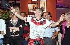 Leading the festivities: Schweinsteiger at the post-match celebrations...