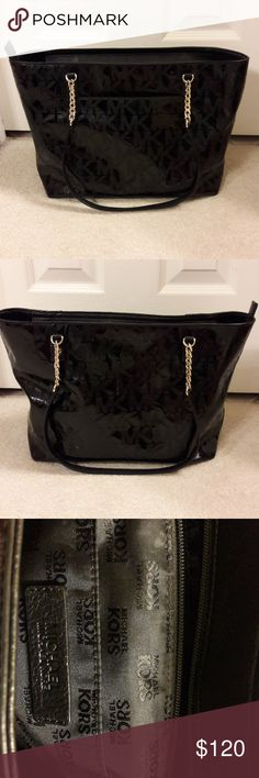 "MICHAEL KORS Authentic MICHAEL KORS  black medium size handbag in perfect condition. Zipper close at the top. Several inside pockets and one outside pocket. Size is 12"" long and 9"" high. Perfect addition to any wardrobe! Michael Kors Bags Shoulder Bags"