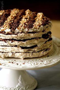 Meringue cake with hazelnuts and chocolate (Tort bezowy z orzechami laskowymi i czekoladą) in polish