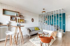 small interior with retro furniture and pastel colors