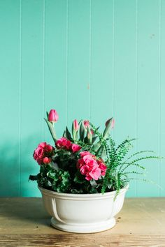 acc6b144909 A spring container garden by Carmen Johnston Gardens featuring pink tulips