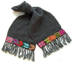 "jennykrauss.com Soft baby alpaca scarves are hand woven by a fair trade group in Cuzco, Peru. When the weaving is finished the scarves are sent to Ayacucho, Peru, where the hand embroidery is applied by another fair trade group. Scarves measure 68"" x 10"" and are available in six colorways: black, gray, black/gray herringbone, brown, camel, brown/camel herringbone. Scarves Showcase 