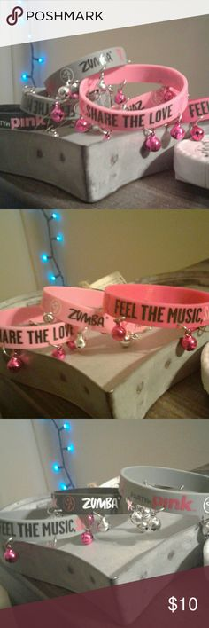 7 zumba breast cancer awareness bands with bells Zumba breast cancer awareness bands with bells, pink, light pink, grey, and black originally i bought them for 5 bucks each zumba Jewelry Bracelets