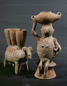 ISRAEL SCULPTURE 5TH-2ND MILL.BCE    Woman carrying a churn on her head and a ram with cornets on its back. From Gilat in the Negev. Pottery figurines, Chalcolithic Period  Israel Museum(IDAM), Jerusalem, Israel