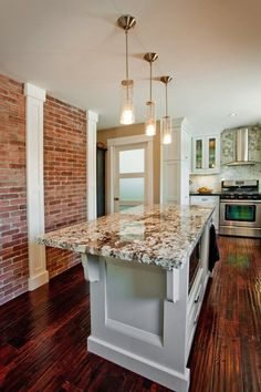 white kitchens with exposed brick and dark floors | kitchen hardwood floors, white kitchen cabinets, inset cabinets, white ...