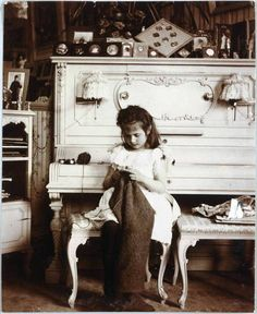 Grand Duchess Anastasia of Russia knitting in her mother's boudoir