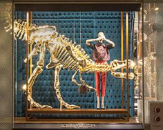 louis vuitton's gilded dinosaur skeleton display -- is it wrong to covet this?
