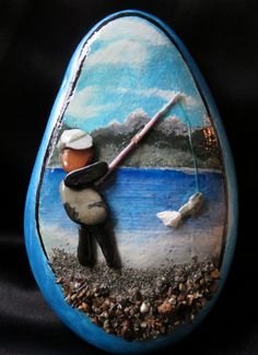 pebble art pebbleart painted rock stone ocean beach fishing fish water ocean sea urchin spine fisherman