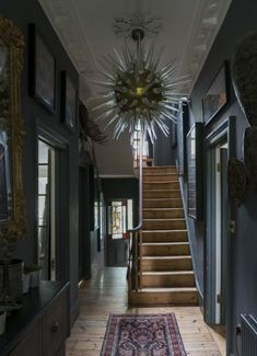 Like a fairy tale brought to life, this Gothic house has unexpected twists, with angels, insects – and even a unicorn – at every turn Victorian Hallway, Victorian Townhouse, Edwardian House, Victorian Homes, London Townhouse, 1930s Hallway, Dark Staircase, Dark Hallway, Staircase Design