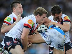 Daniel Conn Photos - Mitchell Aubbusson of the Roosters makes a tackle during the First NRL Preliminary Final match between the Gold Coast Titans and the Sydney Roosters at Suncorp Stadium on September 24, 2010 in Brisbane, Australia. - NRL 1st Preliminary Final - Titans v Roosters