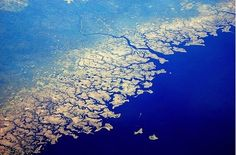 This stunningly complex fractal shoreline is none other than the pan handle of Florida.