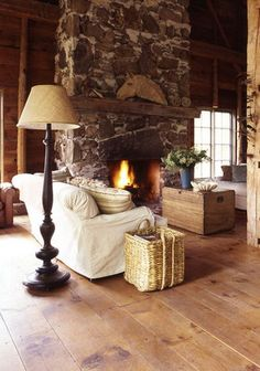 stone fireplace, linen sofa .. wide plank flooring ..  tall ceiling .. where's my cup of tea, huh?