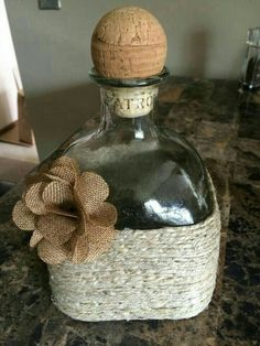 Easy to make :-) Hemp twine, patron bottle, burlap rose Patron Bottle Crafts, Liquor Bottle Crafts, Wine Bottle Art, Alcohol Bottles, Diy Bottle, Bottles And Jars, Patron Bottles, Glass Bottles, Beer Bottle