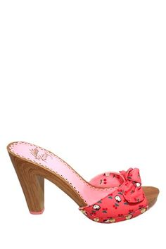 """A trendy """"Hello Kitty"""" platform sandal stylish for any sizzling sunny day. Choice of 4 colors.  - Open toe  - Bow at vamp  - Printed fabric with studded trim"""