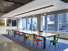 Gensler brings fresh ideas to Whole Foods regional headquarters in Chicago. Chairs at the lunch table in the kitchen are all modern classics.  Photography by Eric Laignel.