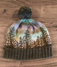 Knit a Hat That Looks Like a Bob Ross Painting, designed by Camille Descoteaux #knitting #bobross #happylittleaccidents
