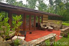 """Wright's Duncan House is a step back in time. Features include the """"gallery"""" hallway to the bedrooms and a back patio that serves as a natural extension of the house. Photo by Chuck Beard"""