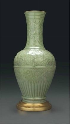 A large Longquan celadon carved baluster vase, China, Yuan dynasty (1279-1368)