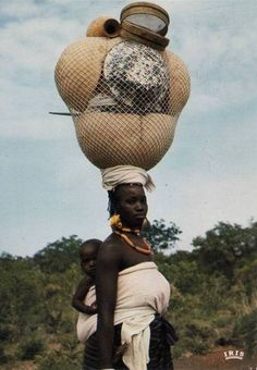 Africa | Mother with child carrying a heavy load.  Senegal | Scanned postcard; published by IRIS