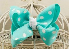 Handcrafted Polka Dot Boutique Bow.  Diamond Blue hair bow with dots.