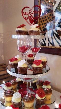 Lovely red, white and chocolate cupcakes with a improvised cupcake stand