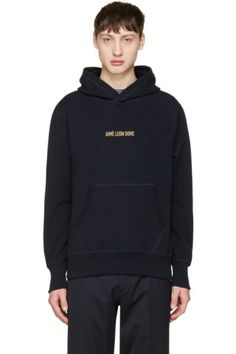 Long sleeve French terry hoodie in 'dark midnight' navy. Fading throughout. Logo embroidered in gold-tone at chest. Kangaroo pocket at waist. Logo flag at side-seam. Rib knit cuffs and hem. Tonal stitching.