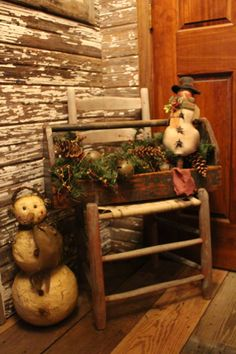 Primitive tool box and snowmen