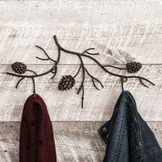 Pine Branches Wall Coat Rack - Bring a hint of nature to your entry with the black metal Pine Branches Wall Coat Rack with realistic pinecones and three hooks for hanging. Measures 19 x 2 x ~ Pine Branch, Branches, Lodge Style Decorating, Decorating Ideas, Woodsy Decor, Cabin Bathrooms, Cabin Bathroom Decor, Bathroom Ideas, Metal Coat Hangers