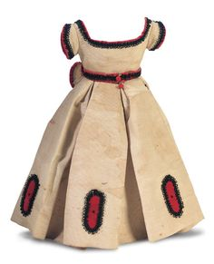"""Couturier-made, probably for Huret, ivory silk faille gown with trim of red velvet, black silk thread loops, and black glass beads; has detachable red velvet belt and box-pleated and velvet/bead edged bustle. Circa 1860. For 16"""" to 17"""" poupée."""