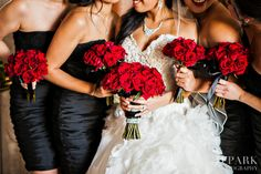 Dark romance, red, black and white wedding bridesmaid dresses. Probably would have bridesmaid flowers white and mine red