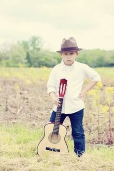 A boy and his guitar photo