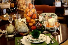 A stunning Thanksgiving Table Setting featuring our Grand Illumination Hurricanes and royal scroll pattern!
