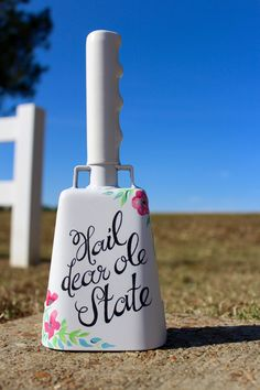 Hand painted cowbell with the classic Hail Dear Ole State on the front and gold on the back. This design would be perfect for the feminine State fan to