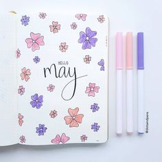 Bullet journal monthly cover page, May cover page, flower drawings. | @dotsandpens