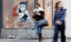 Artwork featuring young girl from Les Misérables appeared on French embassy in London following reports CS gas was used to clear parts of the camp