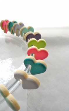 I'm just a sucker for little special treats. heart cookies that hook onto your cup! {love}