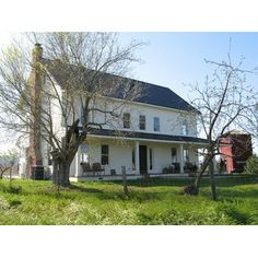 HousePlans.com 485-1 - This traditional farmhouse was inspired by the simple classical composition of the old American farmhouse.