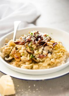 Risotto is a classic that everyone should know how to make. This is the easiest and BEST recipe for a beautifully creamy Chicken and Mushroom Risotto!