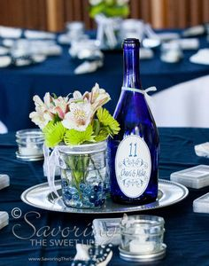 Empty blue wine bottle - table centerpiece and table number.  Savoring The Sweet Life: Reception Fun! The Wedding of Cheri and Mike San Diego, Del Mar, Powerhouse Park Engagement and Wedding Photographe...