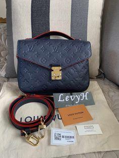 63ad967f57fe Authentic Louis Vuitton Pochette Métis Monogram Empreinte Marine Rouge
