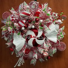 Peppermint Christmas wreath with lots of candies. This beautiful wreath will make a statement on your door. Matching Christmas ribbons and premium deco mesh with ornaments and swirl picks to compliment. Use code localpickup for free shipping if delivery address is within Galveston County, Texas,USA. | Shop this product here: http://spreesy.com/thepolisheddoor/84 | Shop all of our products at http://spreesy.com/thepolisheddoor | Pinterest selling powered by Spreesy.com