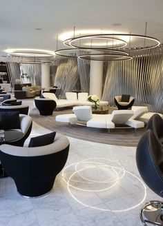 ME Hotel in London| Hotel lobby interior with a circular lighting fixture. | Find more inspiring lighting designs and solutions for your hospitality projects at Unique Blog http://delightfull.eu/blog/