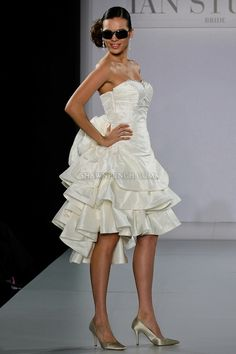 Couture Ian Stuart Bridal ... Here's a dress with attitude. Great details & silhouette.