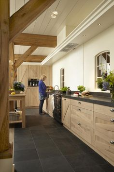 slate floor , wood cabinets , timber framing